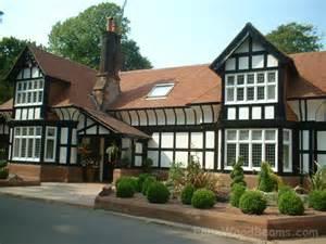 Wood Tudor Style Homes