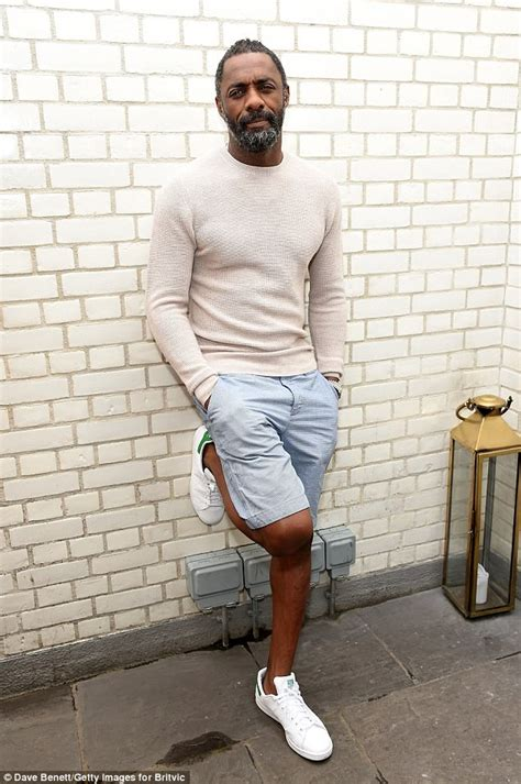 Idris Elba works casual style for Purdeys campaign launch ...