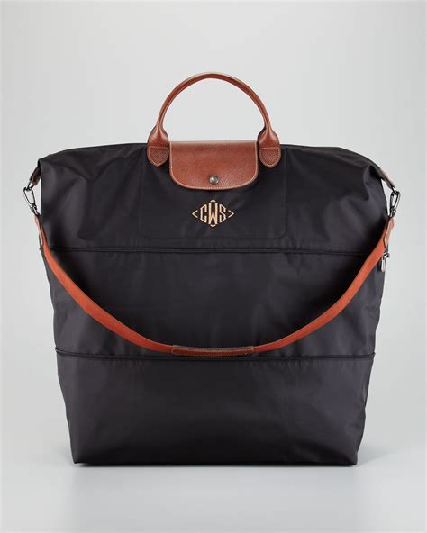 lyst longchamp le pliage monogrammed expandable travel bag  black