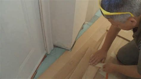 how to lay out a room for laminate flooring how to install glue down hardwood floors over concrete in an uneven shaped room