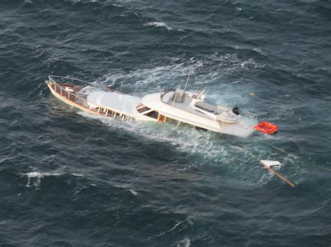 Sinking Boat by Coast Guard Rescues Two From Sinking Yacht In Washington