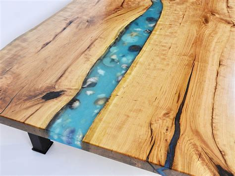Epoxy live edge river table most epoxy tables are made with expensive resin and colored dye that can seem overwhelming. Live Edge River Coffee Table With Seashells   Hokoben, NJ