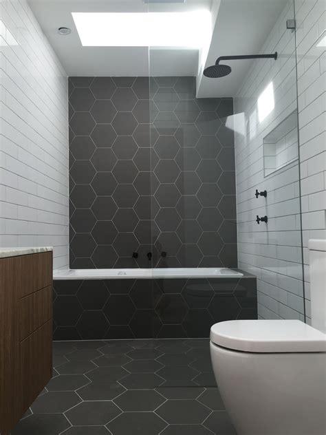 hexagonal tiles monochrome bathroom matt black fittings