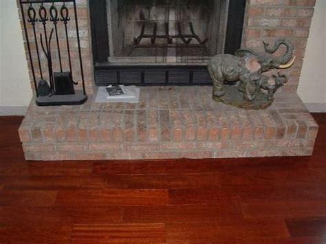 installing laminate flooring around stone fireplace