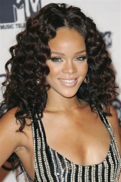 Rihanna Curly Hairstyle by 40 Rihanna Hairstyles To Inspire Your Next Makeover Huffpost