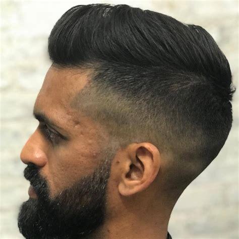 gorgon barbers sanjay with the haircut and beard work