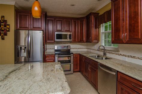 granite countertop colors with cherry cabinets