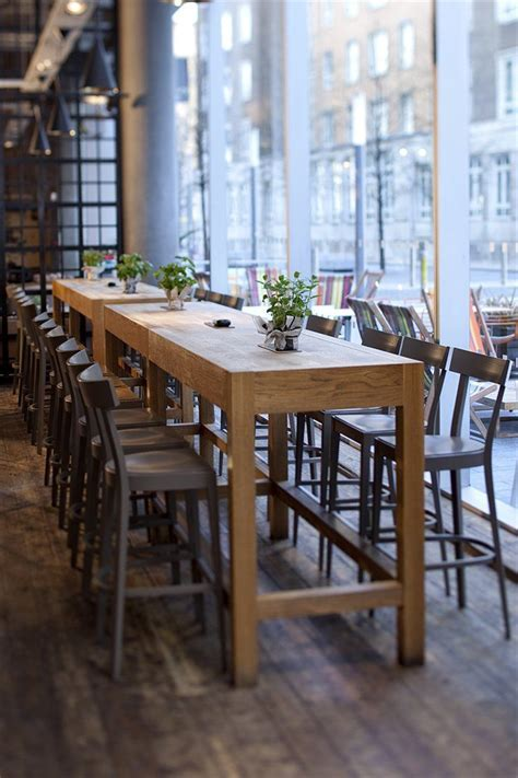 Tall, long, family style seating could be cool in a bar