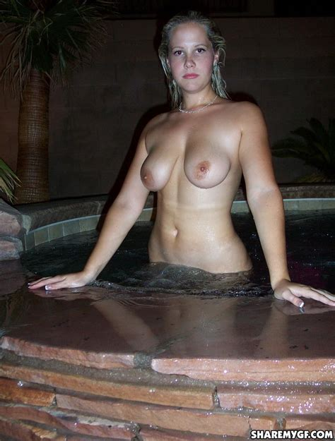 Busty Blonde Girlfriend Plays Naked Out By The Pool For
