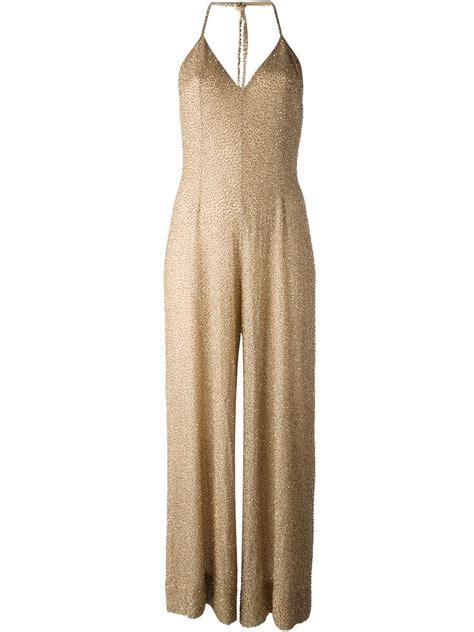 retro jumpsuit vintage flared jumpsuit in gold metallic lyst