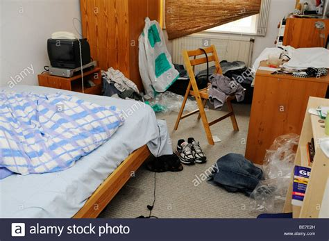 untidy cluttered bedroom  disarray messy bed boys room