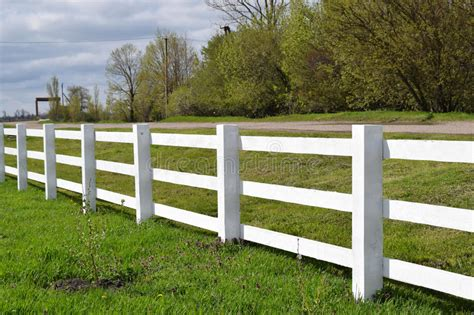 white wooden fence around the ranch stock image