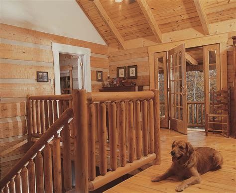 Loft area with timber ceiling & outdoor porch Log cabin
