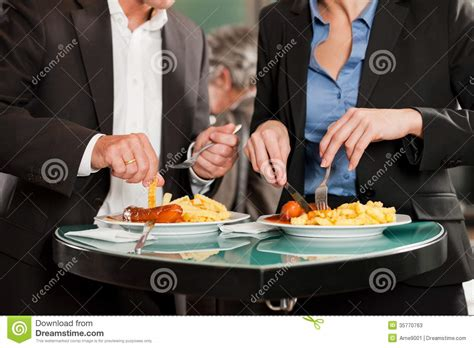Business People Eating Delicious Food Together Stock Image