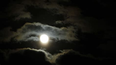 moon and moody sky fast moving clouds and a