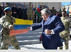 Azerbaijani Official Destroys Colombian Flag Taking it for