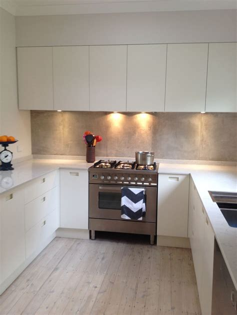 Top Kitchen Ideas - recessed handles silestone lagoon bench top concrete look splash back white washed floors
