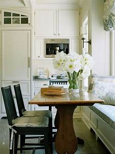 appealing small kitchen with wooden dining table balck