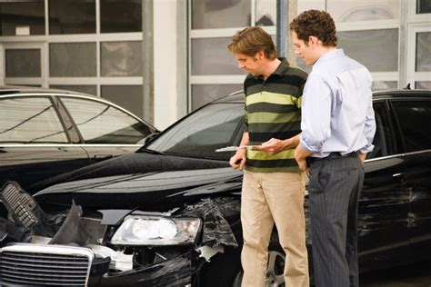 Tauto Claims Adjuster Assessing Damage To A Vehicle
