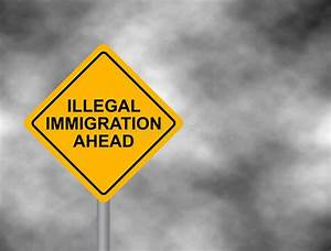 Yellow Road Sign With Illegal Immigration Ahead Message ...