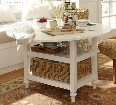 small round kitchen table with leaves that drop to make a