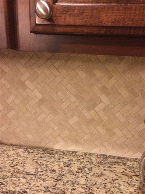 herringbone travertine tile backsplash stone
