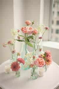 sign wine bottle guest book pink floral arrangements in glass bottles photo by mgb
