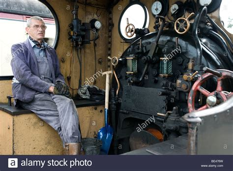 Steam Engine Driver Sitting In Cab On Footplate Of Steam