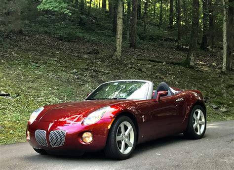 wicked red solstice  pontiac car show