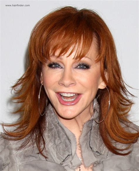 reba mcentire long chiseled hairstyle