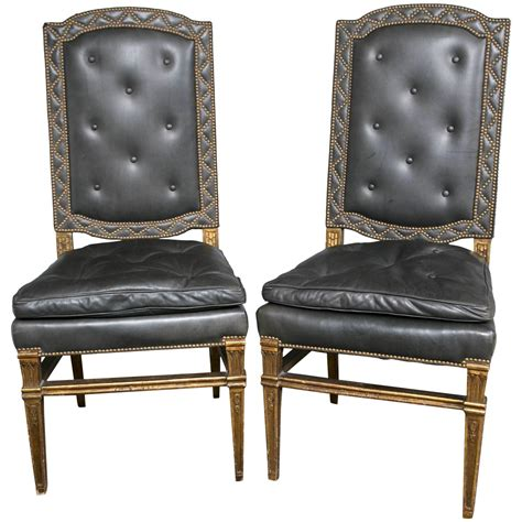 pair of leather side chairs with nailhead design karges