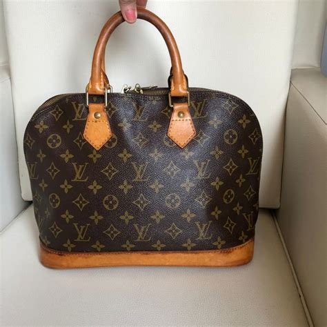 louis vuitton alma monogram bag  reserve price