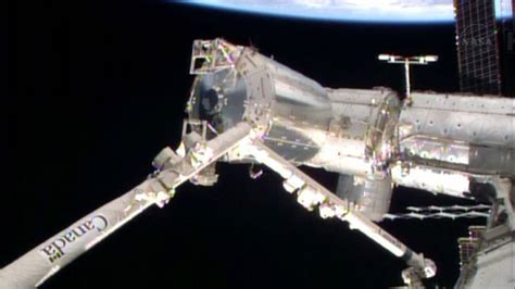nasa astronauts complete first spacewalk to repair international space station cooling system