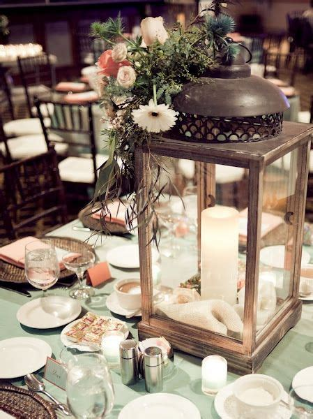 Lantern and a candle for centerpieces simple but elegant
