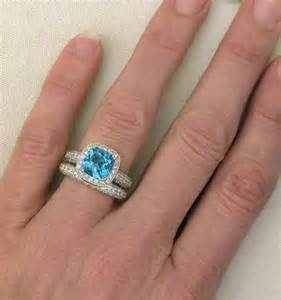 topaz engagement ring cushion cut blue topaz and halo engagement ring and wedding band with milgrain edging