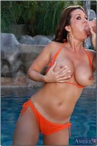 bikini clad woman raquel devine teasing by the poo