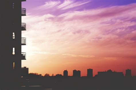 silhouette photo  city building  sunset
