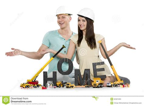 Home Under Construction Happy Couple With Machines