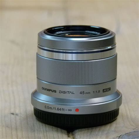 Olympus 45mm F1 8 Lens used olympus m zuiko 45mm f1 8 silver micro four thirds