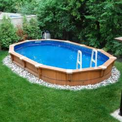 pool backyard designs minimalist elips shape above ground pool deck green atmosphere