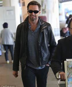 Les Miserables star Hugh Jackman has staff in fits of giggles at LAX airport | Daily Mail Online