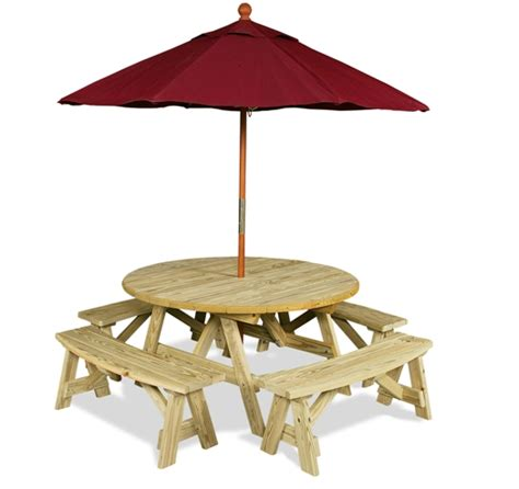 wooden picnic table with umbrella water fountain big stones and water play area gazebo ou