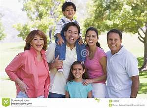 Extended Family Standing Outdoors Smiling Royalty Free ...  Extended