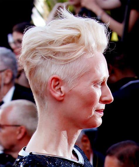 tilda swinton short wavy casual mohawk hairstyle light blonde hair color