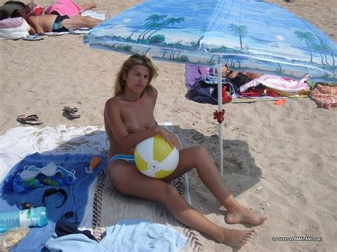 Amateur Blonde Wife Going Topless At The Beach Porn