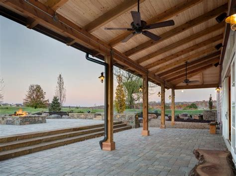 slanted wood roof supported  columns stretches