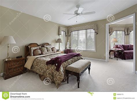 Candice Olsen Bedrooms by Master Bedroom With Adjacent Sitting Room Royalty Free