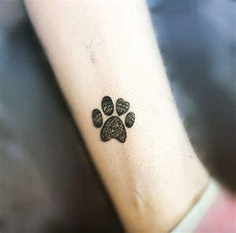 tiny paw print tattoos  cat  dog lovers revelist