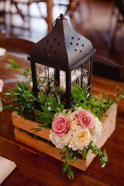 Lantern Centerpiece On A Farm Table Outdoor Wedding