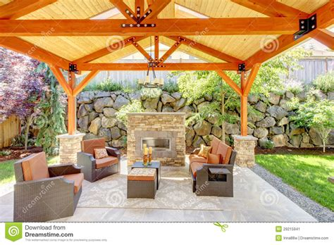 exterior covered patio with fireplace and furniture stock